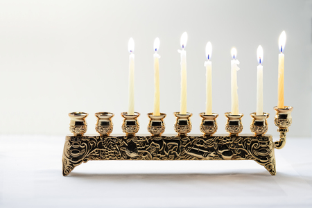 The Symbols of Hanukkah - nine-branched mehorah Hanukiah Stock Photo
