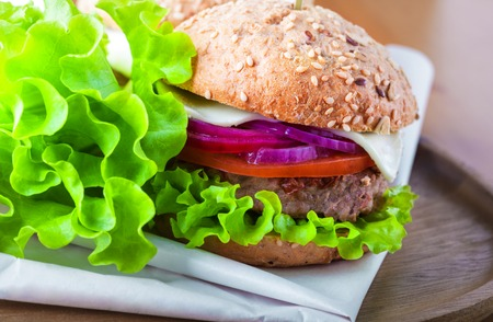 Cheeseburger with salad, onion Stock Photo