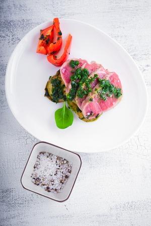 A plate of sliced roast beef