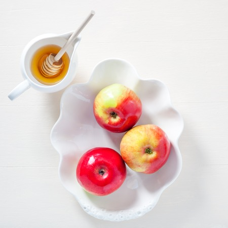Apples, pomegranate and honey for Rosh Hashanah Stock Photo