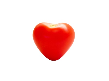 Heart shaped single tomato isolated on a white background
