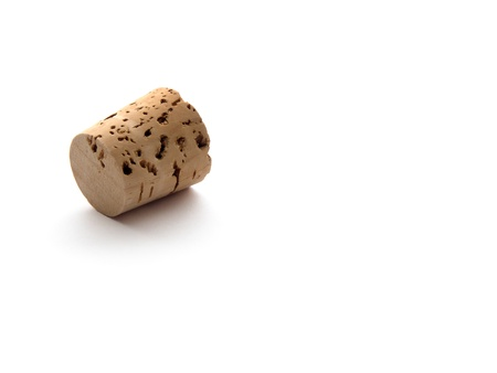 Cork laying down on white background
