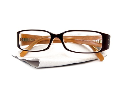 Eye Glasses over cleaning microfiber cloth  in white background