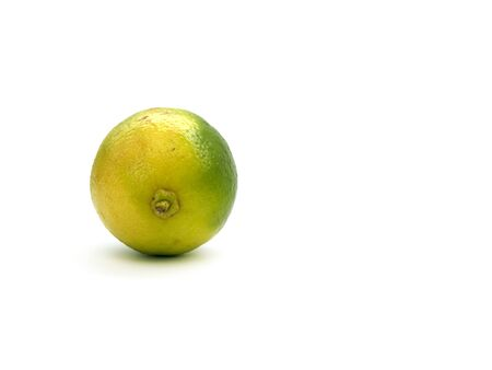Single lime isolated on a white background Stock Photo