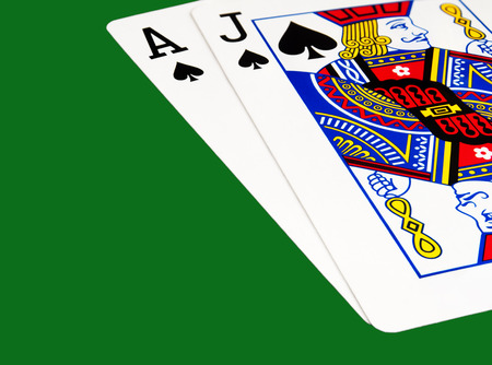 Black Jack and Black Ace on green background with clipping path