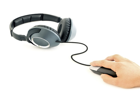 Music headphones connected to computer mouse with male hand