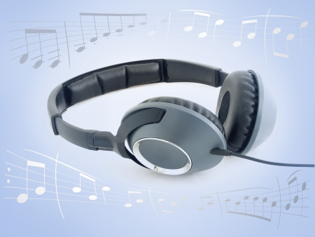 Music headphones over gradient blue background surrounded by music sheet notes