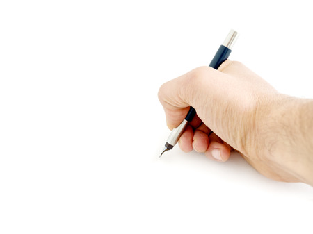 Male hand writing and holding a blue pen isolated on a white background Stock Photo