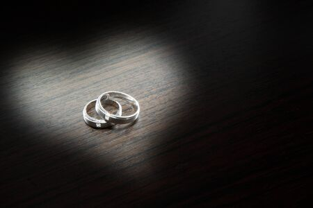 a couple of platinum diamond rings photo