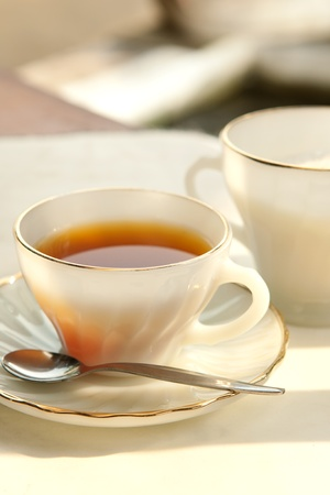 a cup of tea, served with sugar, taken in the evening photo