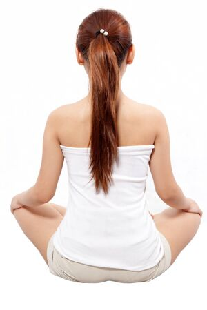 woman in meditation pose taken from behind photo