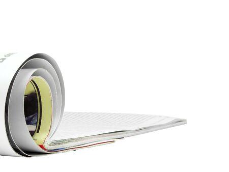 Rolled magazine isolated over white background Stock Photo