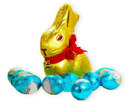 Easter bunny and eggs over white background