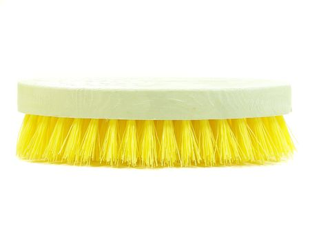 Yellow plastic scrub brush over white background Stock Photo - 4671140