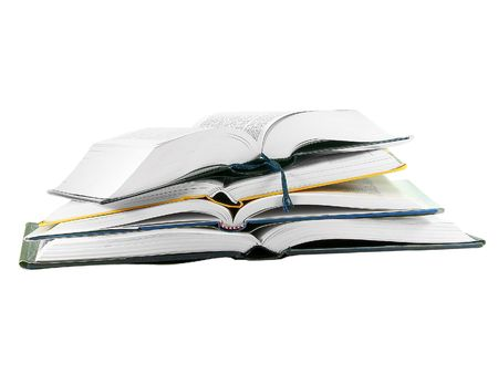 Pile of open books isolated over white background photo