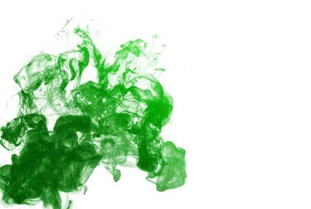 Green puff of smoke over white background photo