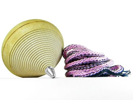 Spinning wooden top with colored rope over white Stock Photo