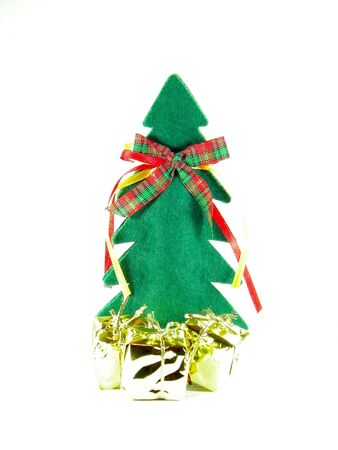 Christmas tree made of fabric with golden wrapped gifts Stock Photo - 6015871