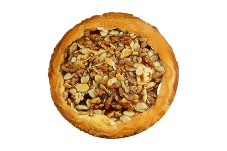 Almonds and walnuts pie isolated over white background photo