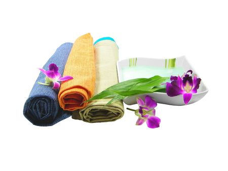 Towels flowers and perfumed balm isolated over white background photo