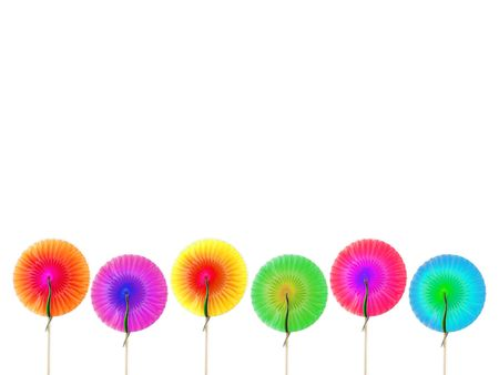 Cocktail round decorations made of colored paper isolated over white background photo
