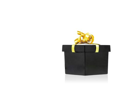 Black gift box with golden ribbon isolated over white background photo