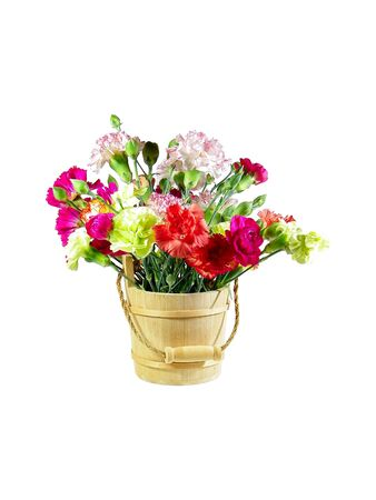 A wooden bucket full of carnations isolated over white background photo