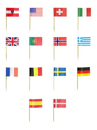 Tootpick flags of various countries isolated over white background photo