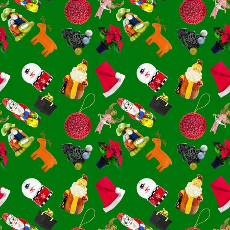 Seamless pattern with green background and Christmas themed stuff photo