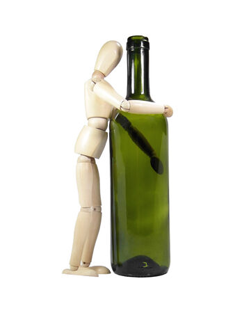 proportions of man: Wood puppet embracing empty wine bottle isolated over white background Stock Photo