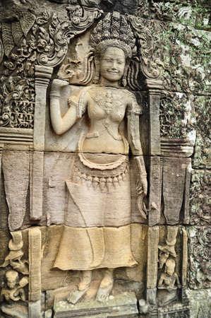 Apsara carved on the wall at bayon, cambodia photo