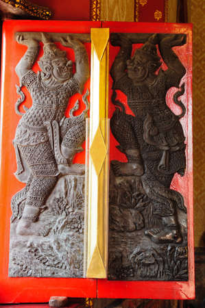 Traditional Thai style carving on window of Wat Benjamobopith photo