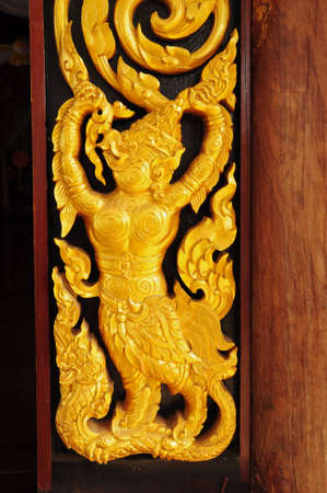 Laithai carved  on the door at temple photo