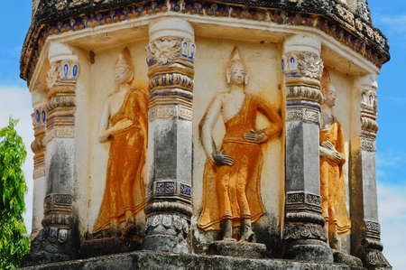 Stone buddha statue on a pagoda wall, Temple in Thailand photo