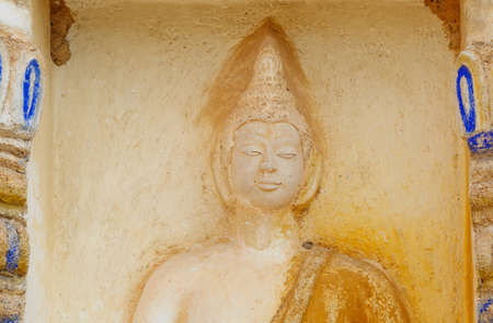 patriarchal: Stone buddha statue on a pagoda wall, Temple in Thailand