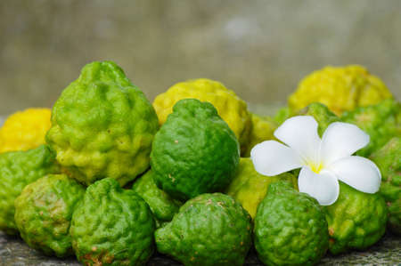 image of Kaffir Lime on the stone table photo