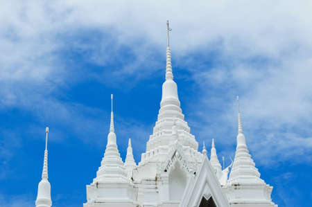 scene of white pagoda and blue sky in Thailand photo