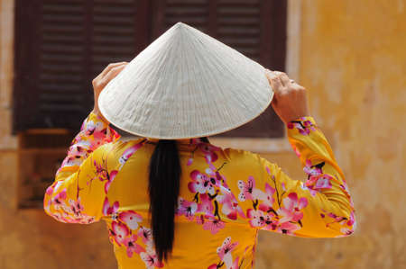 yellow dress: Vietnamese Woman Stock Photo