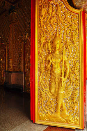 Angel decoration of buddhist temple in Thailand photo