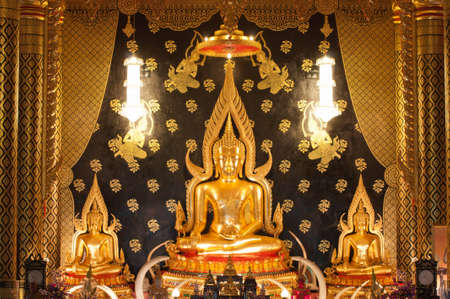 Golden Buddha Statue in the temple, Thailand photo
