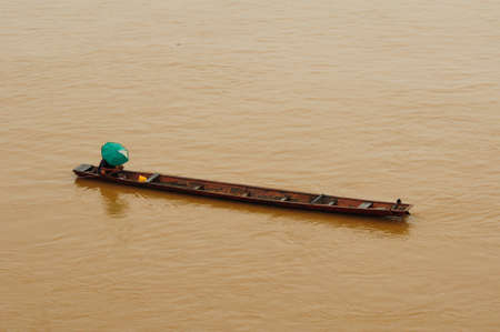 Fisherman in the boat at Mekong River photo