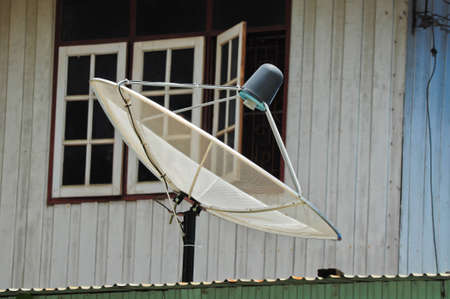 installed: The satellite dish is installed on the roof Stock Photo