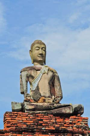 ruins of buddha statue at Chaiwatthanaram Temple, Ayutthaya Historical Park, Thailand photo