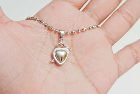 platinum pendant on hand and white background photo