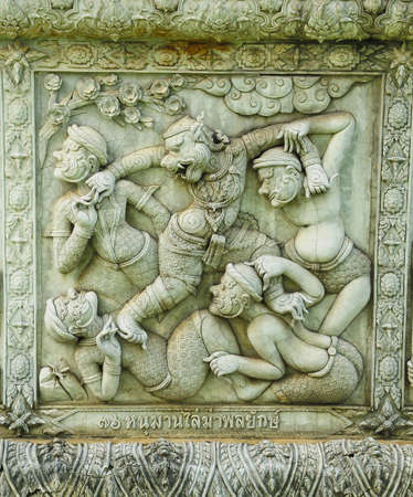 ramayana statue on wall of fence at Wat Panan Choeng temple in Ayutthaya Thailand photo