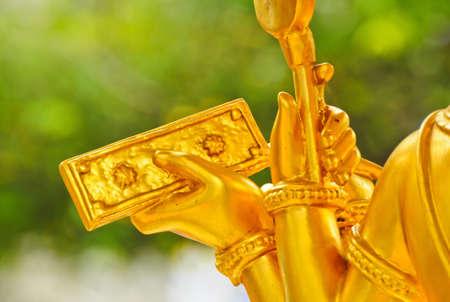 closeup hand of Golden Statue  Brahma in Thailand photo
