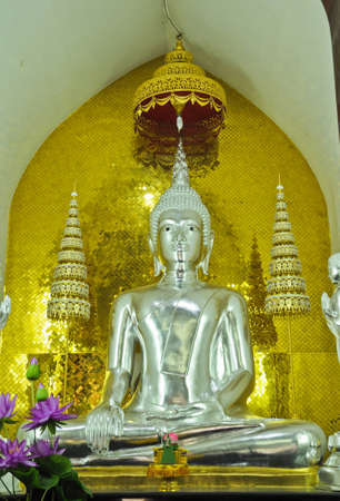 ancient silver buddha statue at the temple, Thailand photo