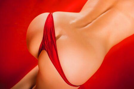 half nude: half nude woman showing bum buttocks in red panties Stock Photo