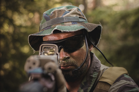 marksman: commando aiming a rifle Stock Photo