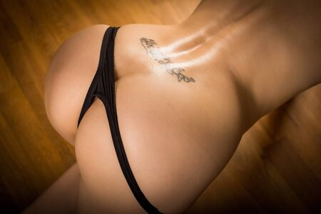 half nude: beautiful half nude woman with wet buttocks and back Stock Photo